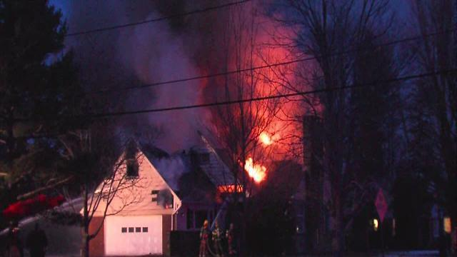 Firefighters battle house fire in Orange