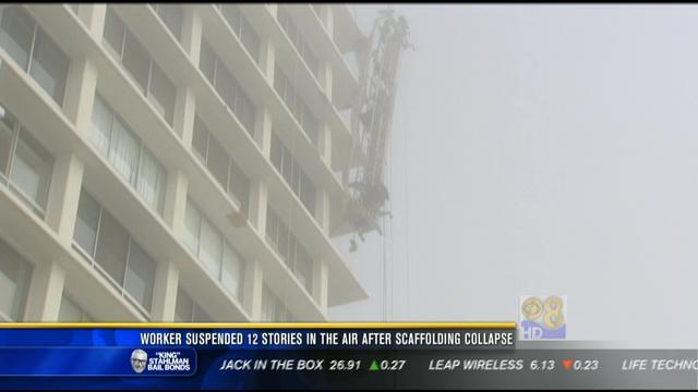 Worker suspended 12 stories in the air after scaffolding collapse
