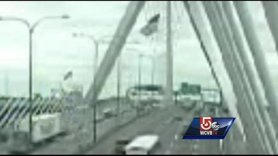 American flag on Zakim falls on vehicle, causes crash