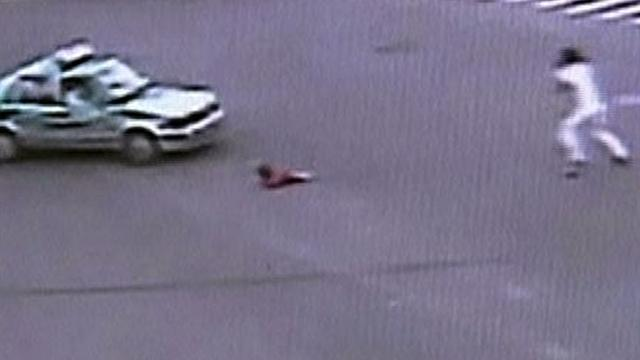 Dad leaps out of moving car to save child