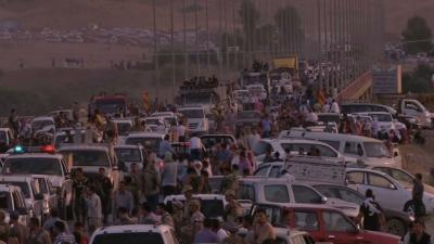 Raw: Thousands Flee Homes in Northern Iraq