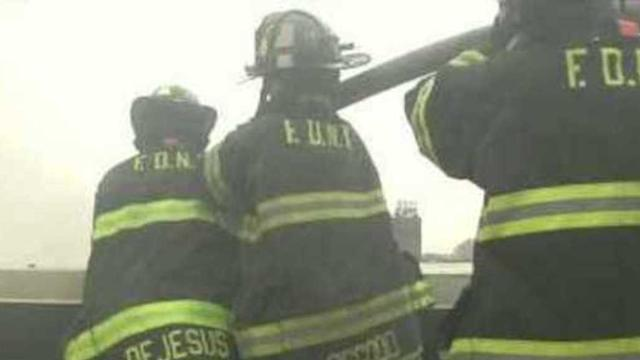 Firefighters Respond to New York Building Collapse