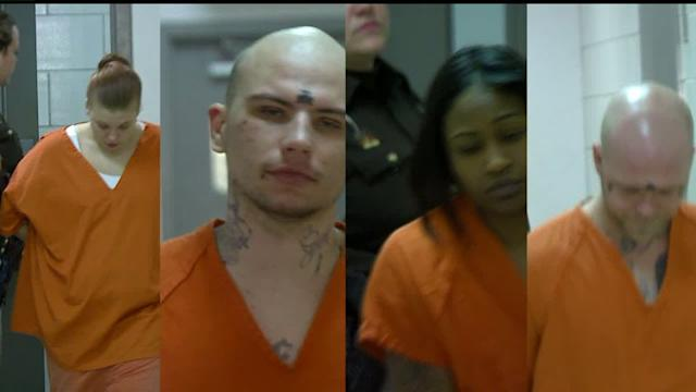 Suspects In Quadruple Slaying Appear in Court