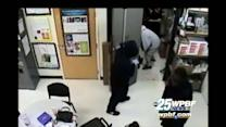 Caught on camera: Armed robbery at T-Mobile store