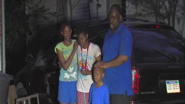 Neighbors save family trapped in fire