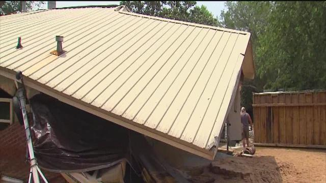 Families in Pensacola assess damage and deal with heartbreaking loss due to devastating floods