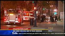 Man armed with rifle shot by police downtown