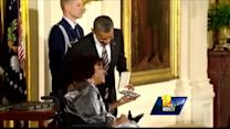 President honors Baltimore woman hit by car