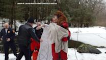 Firefighters rescue dog from frozen pond