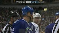 Daniel Sedin pulls tooth out after high stick