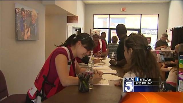 Residents Forced From Their Homes Seek Shelter and Comfort at Evacuation Center