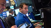 US stocks move between slight gains and losses at midday