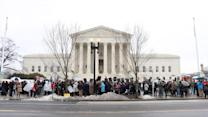 Protesters Rally Outside Supreme Court ACA Hearing