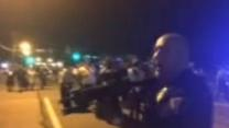 Officer Who Pointed Gun at Protesters Suspended