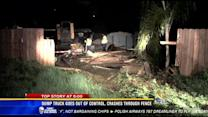 Dump truck goes out of control, crashes through fence