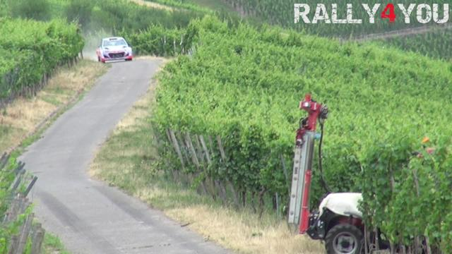 Rally driver comes inches from fatal crash as tractor pulls out in front of him