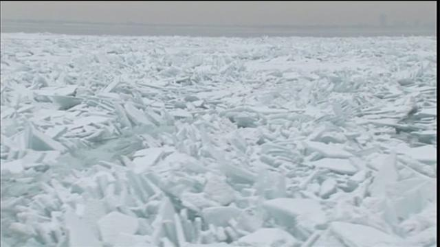 Lake Michigan frozen; icebreaking underway