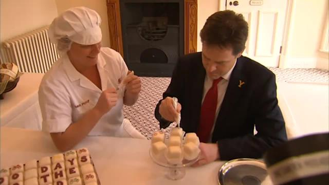 Clegg tries his hand at icing a cake at Bettys in Harrogate