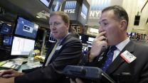 US stocks are mixed as investors assess earnings, deals