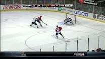 Sharp's defensive play leads to a Toews goal