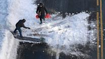 Wall Street Digs Out From Snow, Super Bowl 50 Teams are Set