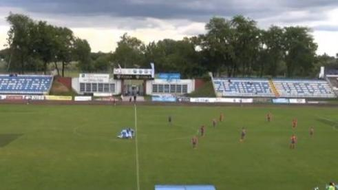 Female football player scores goal from halfway line