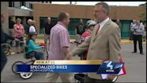 Children with disabilities receive specialized bikes