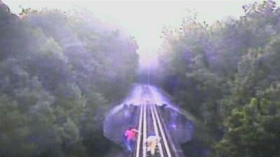 Two Women Narrowly Avoid Being Hit by Train
