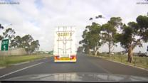 Dash-cam captures truck's close call with ambulance