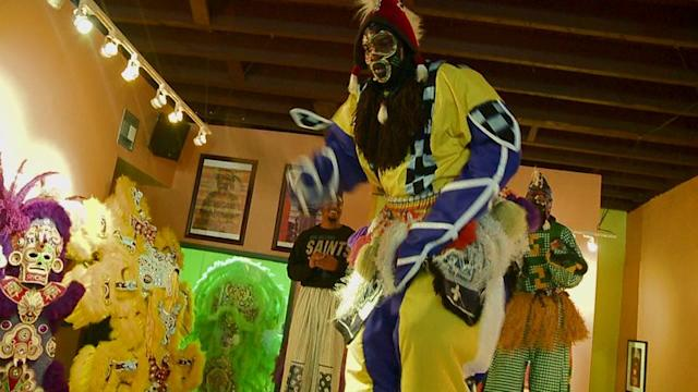 How Stilt Dancers Prepare for Mardi Gras