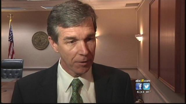 Cooper, McCrory disagree about defending voting lawsuit