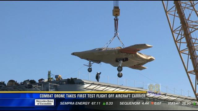 Combat drone takes first test flight off aircraft carrier