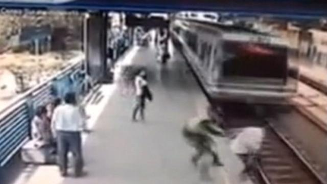 Cop's Last-Second Grab Saves Man from Speeding Train