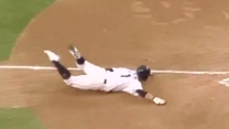 Mad Dash: Korean baseball player flops on slide into home