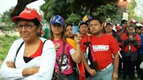 Raw: Chavez Supporters Escort Late Leader
