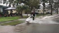Man Rides Jet Ski Through Flooded Streets
