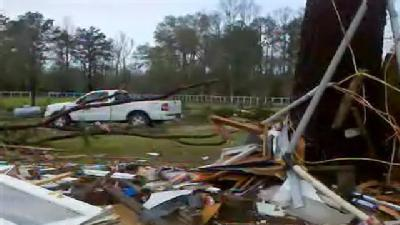 Tornado Throws Woman From Home