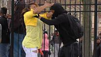 Raw: Woman Confronts Baltimore Protester