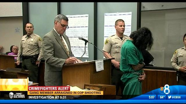 Gang member arraigned in cop shooting