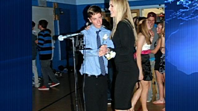 Teen takes Olympic star to high school dance