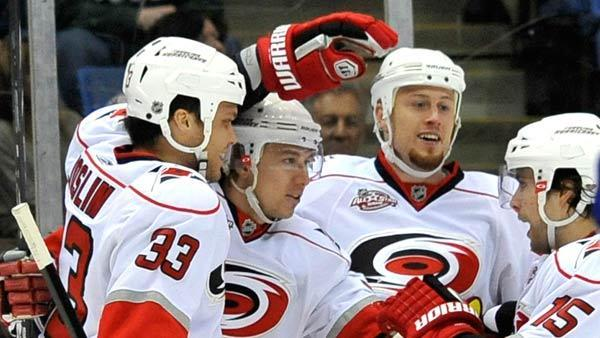 'Canes begin training camp with trades, signing