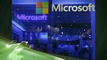 Latest Business News: Microsoft Profit Below Estimates After Tablet Charge