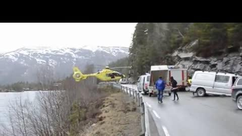 Helicopter Lands on Highway Guard Rail