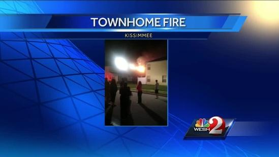Flames shoot through roof of townhome in Kissimmee