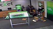 Camera captures employee fight with cell phone store robber
