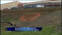 30-foot deep sinkhole forms outside Penn Hills High School