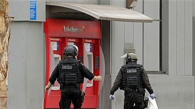 Police: Bank robbed; device strapped to manager