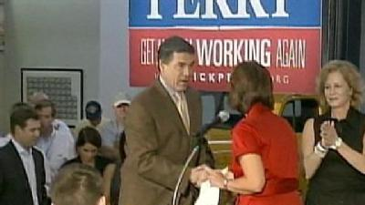 Perry, Romney Storm New England