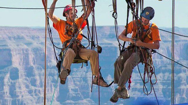 Window cleaners dangle above Grand Canyon
