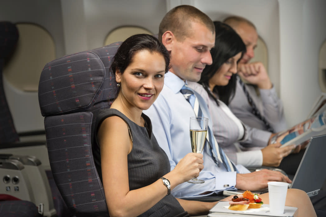 woman having meal on plane